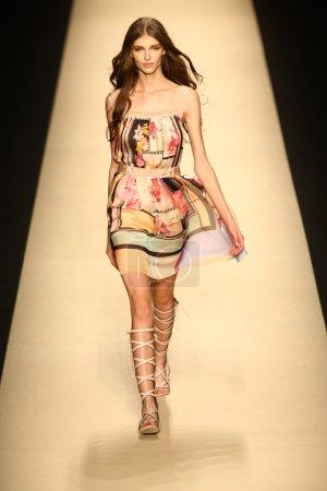 Model walks the runway during the Alberta Ferretti show