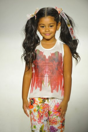 Model walks the runway during the Alivia Simone preview at petite PARADE Kids Fashion Week