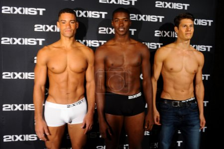 Models pose backstage during 2(X)IST Spring Summer 2015 Runway Show