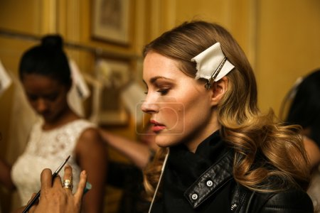 Model getting ready backstage wearing Oleg Cassini Fall 2015 Bridal collection
