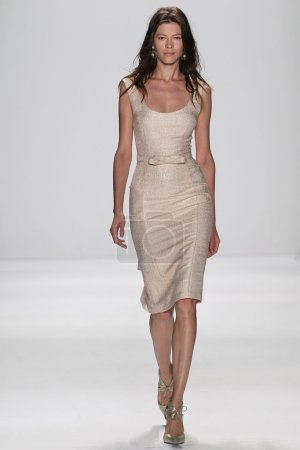 Model walks the runway at the Badgley Mischka fashion show