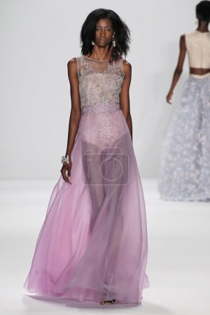 Photo for NEW YORK, NY - SEPTEMBER 09: A model walks the runway at the Badgley Mischka fashion show during Mercedes-Benz Fashion Week Spring 2015 at Lincoln Center on September 9, 2014 in NYC - Royalty Free Image