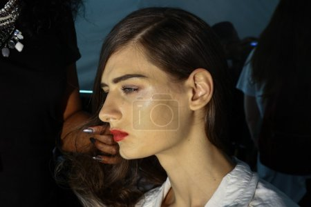 Model getting ready backstage at the Carmen Marc Valvo show during MBFW