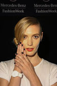 Model poses backstage at Carmen Marc Valvo show during MBFW
