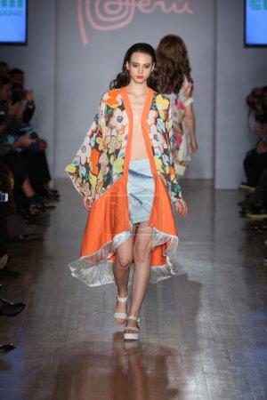 Model walks runway for Emporium presentation