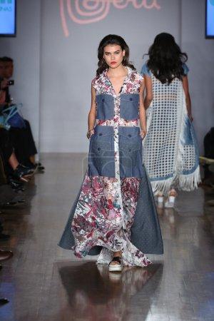NEW YORK - NOVEMBER 19: A model walks runway for E...