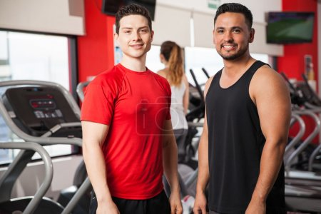 friends in sporty clothing working out