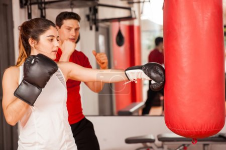 brunette getting boxing lesson