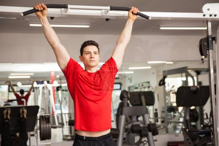 Man concentrating for  pull up workout