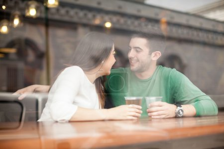 man drinking beer and flirting