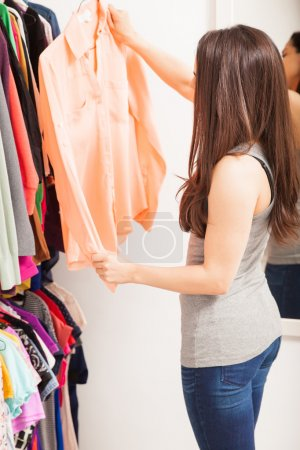 woman deciding what to wear