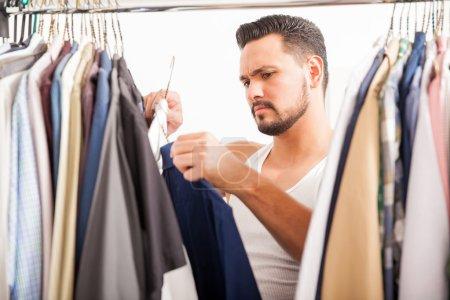 man choosing between to shirts