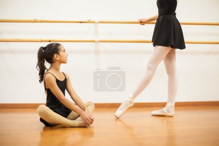 girl looking up to her dance teacher