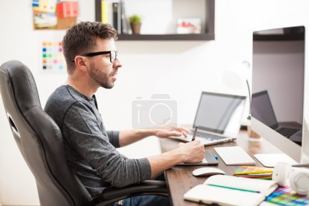 man using two computers