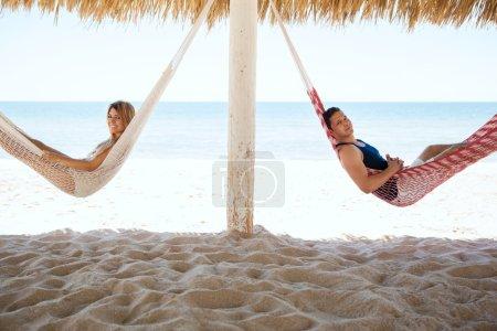 couple lying in hammocks