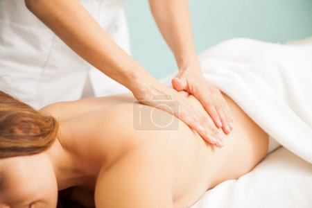 therapist giving a back massage