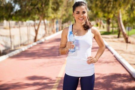 Runner girl holding bottle