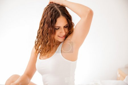 Young woman showing her smooth armpits