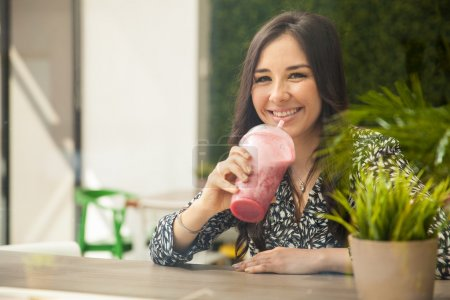 Woman taking a smoothie break
