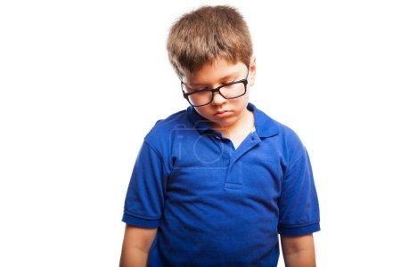 Boy in glasses looking sad