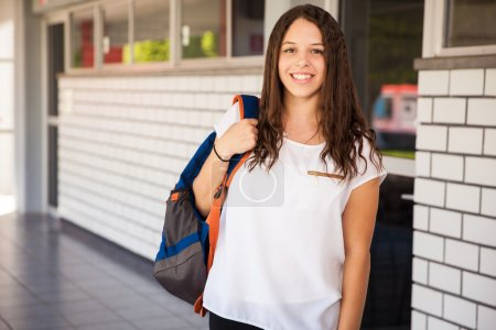 brunette carrying a school bag