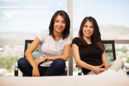 female business partners smiling