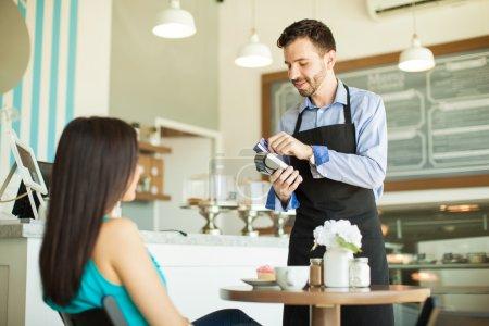 waiter swiping a customer's credit card