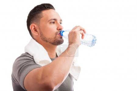 man with a beard drinking water