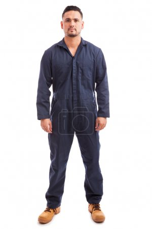 Photo for Full length portrait of a young good looking man wearing overalls for work on a white background - Royalty Free Image