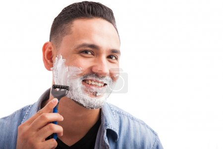 man with shaving cream on his face