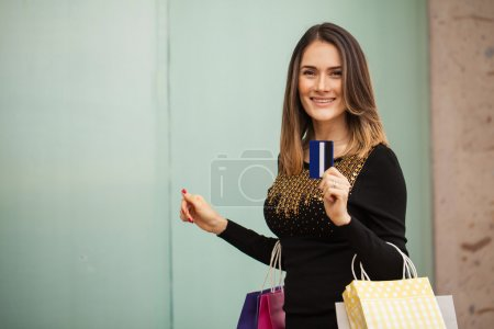 woman showing her credit card