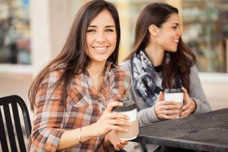 Cute girls having coffee