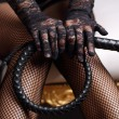 Sensual woman in black lingerie and leather whip...