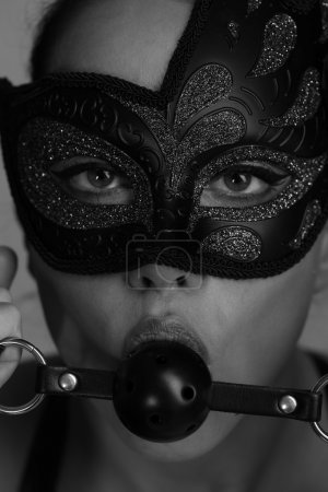woman with mask and ball gag