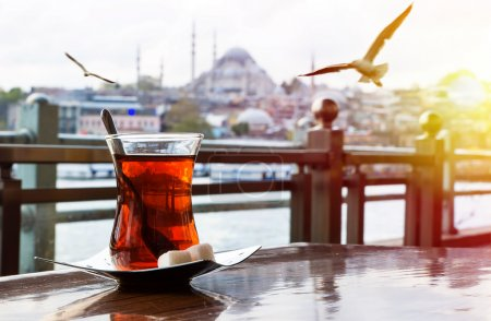 Photo for Cup of turkish tea on the background of port in Istanbul - Royalty Free Image