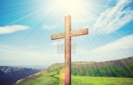 Photo for Old wooden cross religious symbol on green field - Royalty Free Image