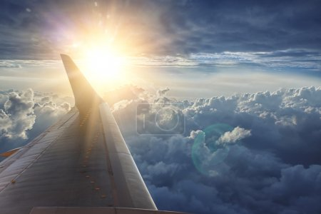 Wing of the plane on blue sky
