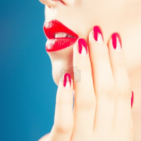 woman with  red lips and nails