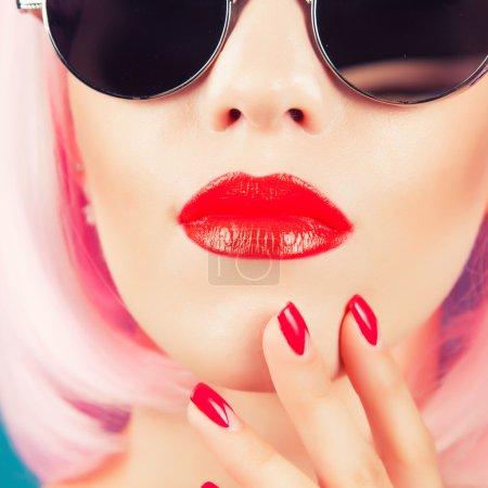 beautiful woman wearing wig and  sunglasses