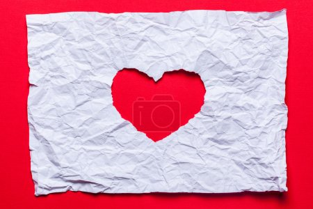 White torn paper in heart shape symbol