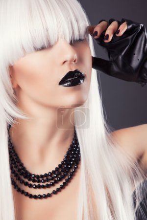 Blonde woman with black make-up