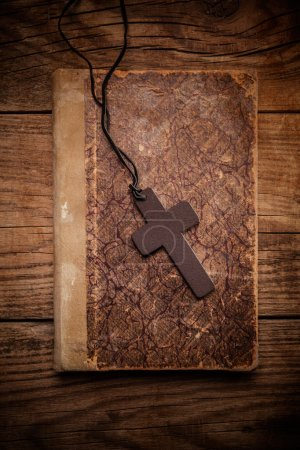 Christian cross on bible