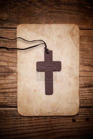 Wooden cross on paper