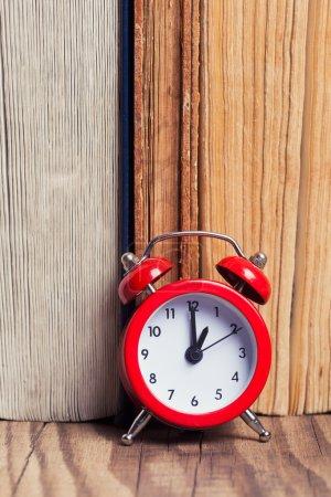 Vintage books and alarm clock
