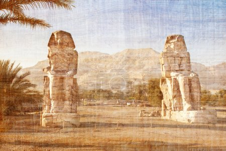 Colossi of Memnon in Valley of Kings on papyrus ba...