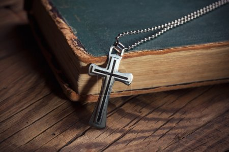 Photo for Close-up of silver Christian cross on bible - Royalty Free Image