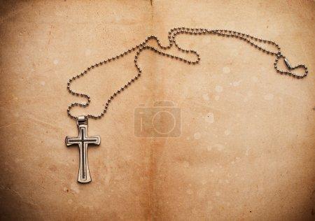 Cross on parchment paper
