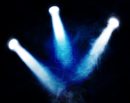 spotlights and smoke in a room