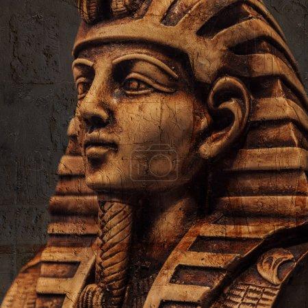 Stone pharaoh tutankhamen mask on dark background...