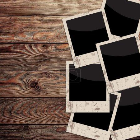 Photo pour Vieux cadres photo sur fond bois vintage - image libre de droit